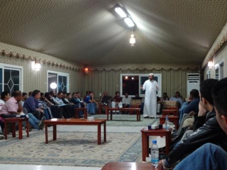 Dr Alrabiah Addressing Staff in a Social Gathering