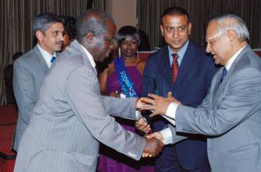 Mr. S.C. Sharma, African Regional Director receives the President