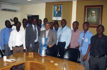 The SCOUL football team with CEO Mr. Bapat, showcasing the district level trophy they won